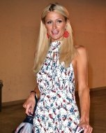 Paris Hilton seen leaving Kitson on Robertson Boulevard wearing a Hello Kitty print dress