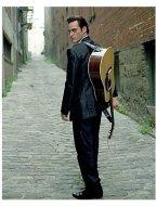 Joaquin Phoenix stars as Johnny Cash in Walk The Line