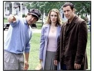 Mr. Deeds movie still: Director Steven Brill discusses a scene with Adam Sandler and Winona Ryder on location