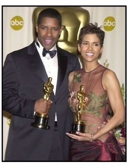 Halle Berry and Denzel Washington backstage at the 2002 Academy Awards