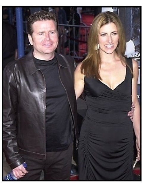 Simon West and date at the premiere of Tomb Raider
