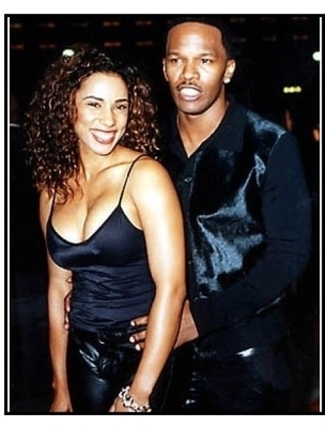 Jamie Foxx and date at the Bait premiere